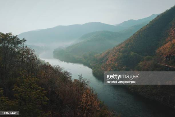 Beautiful River and Mountain Against Sky During Sunrise