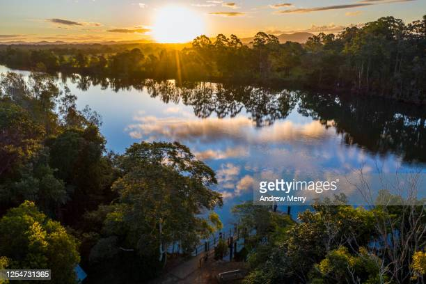 beautiful river landscape with reflection of blue sky and clouds at sunset - port macquarie stock pictures, royalty-free photos & images