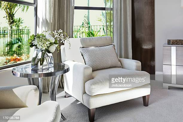 a beautiful, romantic bedroom sitting area with flowers..  - tidy room stock pictures, royalty-free photos & images