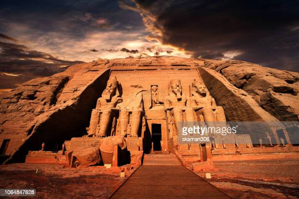 beautiful ruins seated statues of ramesses ii at the great temple of abu simbel. - giza pyramids stock pictures, royalty-free photos & images