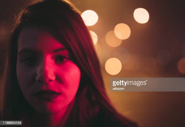 beautiful sad girl - red light stock pictures, royalty-free photos & images
