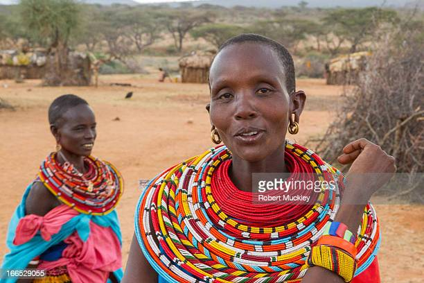 Beautiful Samburu woman wearing traditional red and blue clothes and necklace. Standing behind is young woman also in traditional clothes. The...