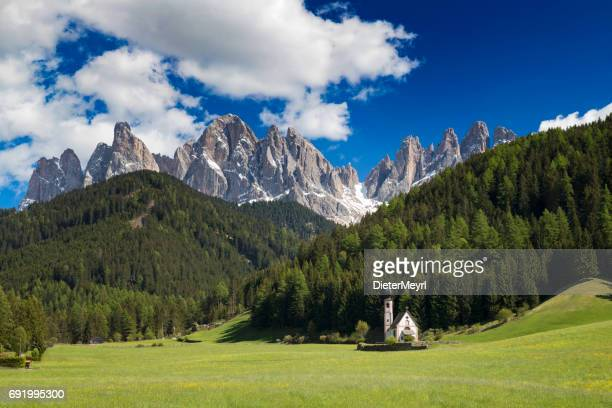 beautiful san giovanni church with the dolomites in the background, south tyrol, italy - sud foto e immagini stock