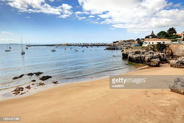 beautiful sandy beach in cascais - cascais stock photos and pictures