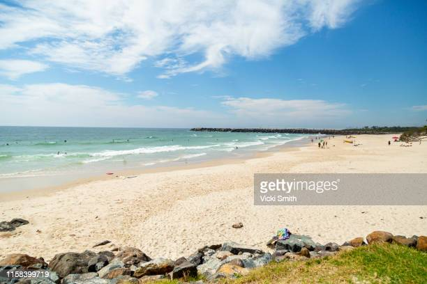 beautiful sandy beach, ocean and blue sky's - newcastle new south wales stock pictures, royalty-free photos & images