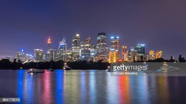 Beautiful scene of colorful Sydney city skyline at night with reflection