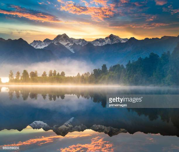beautiful scenery landscape of the matheson lake fox glacier town southern alps mountain valleys new zealand - sunset lake stock photos and pictures