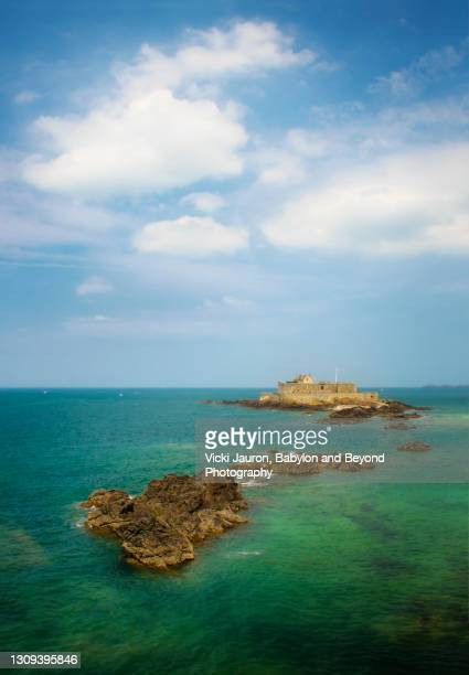 beautiful scenic vertical view of fort national in saint-malo, brittany, france - seascape stock pictures, royalty-free photos & images