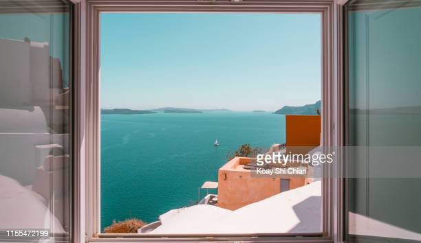 beautiful sea view window - greece stock pictures, royalty-free photos & images
