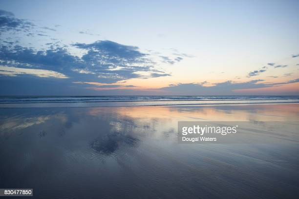 beautiful seascape and reflection at dusk. - dougal waters stock pictures, royalty-free photos & images