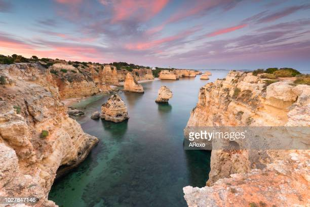 beautiful seascape at sunset in algarve beach, south coast of portugal. - lagos portugal stock pictures, royalty-free photos & images