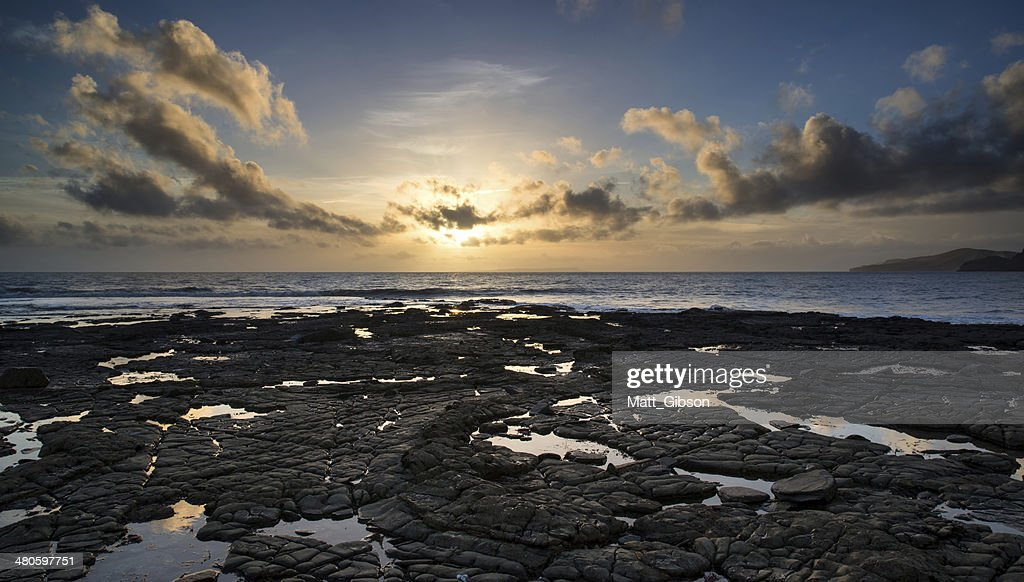 Beautiful seascape at sunset with dramatic clouds landscape image : Stock Photo