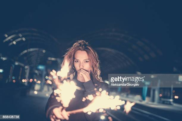beautiful seductive women with sparklers posing at night - seduction stock pictures, royalty-free photos & images
