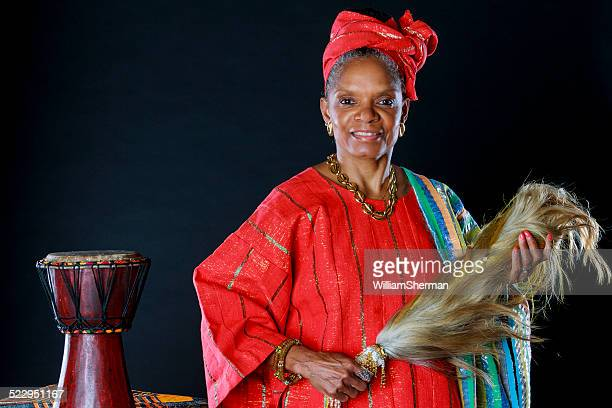 beautiful senior african american female storyteller - dashiki stock photos and pictures