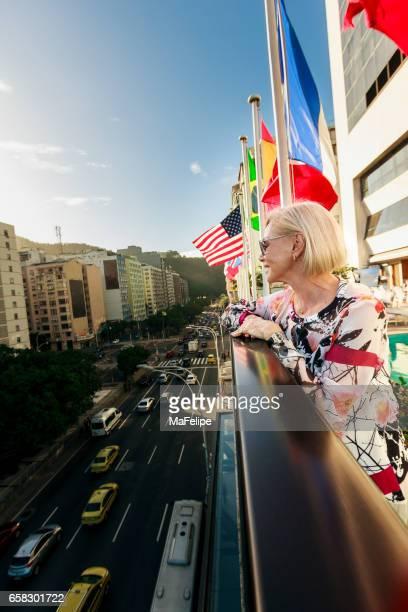 Beautiful senior Brazilian woman on the terrace of a luxury hotel