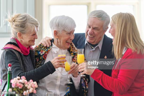 beautiful senior woman celebrating mother's day - mimosa stock pictures, royalty-free photos & images
