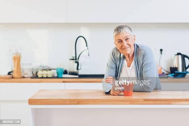 Beautiful senior woman in a domestic kitchen