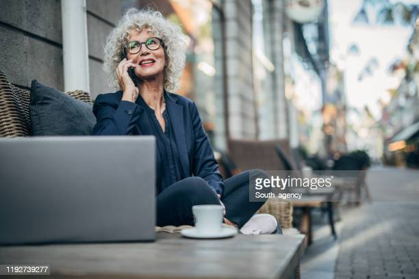 beautiful senior woman in coffee shop - working seniors stock pictures, royalty-free photos & images