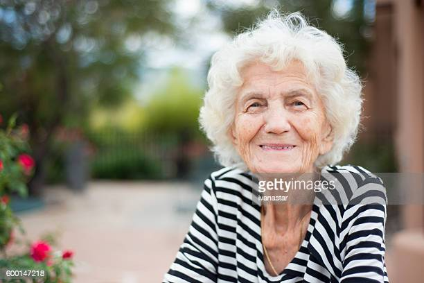 beautiful senior woman portrait happy expression - seniore vrouwen stockfoto's en -beelden
