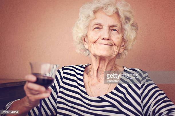Beautiful Senior Woman Portrait Smug Expression Toned Image