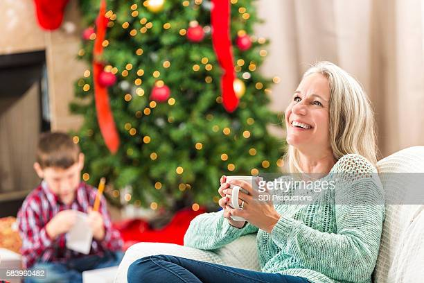 Beautiful senior woman smiles and laughs on Christmas day