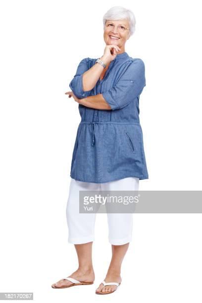 Beautiful senior woman standing on white background