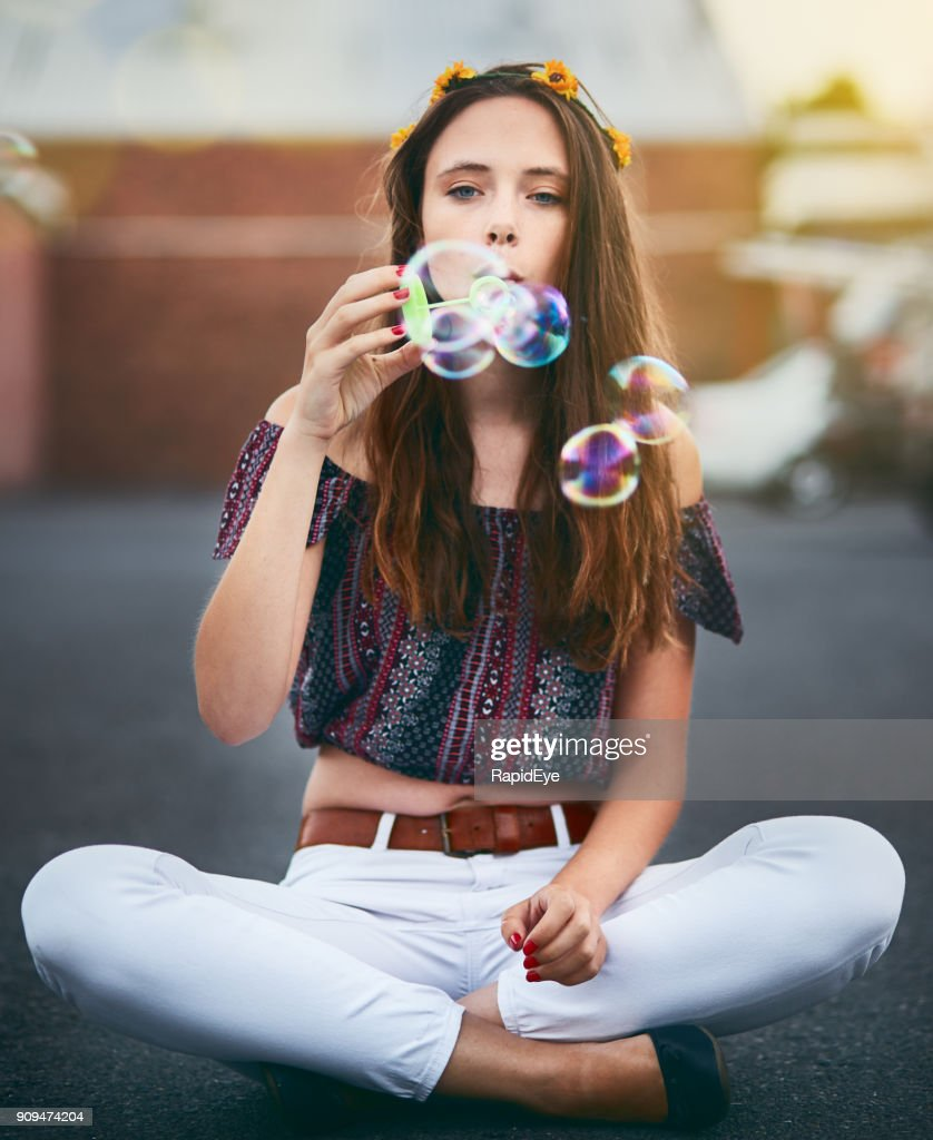 Beautiful serene girl with flowers in hair blows bubbles stock photo beautiful serene girl with flowers in hair blows bubbles stock photo izmirmasajfo