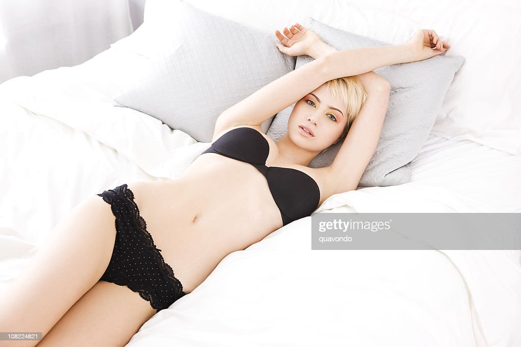 3c863bfca Beautiful Sexy Blond Young Woman in Lingerie on White Bed   Stock Photo