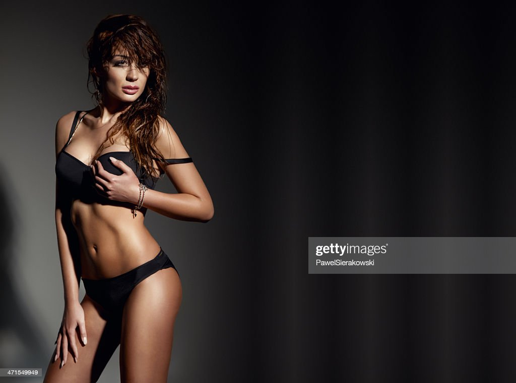 569e80f39 Beautiful sexy brunette woman wearing black lingerie, posing. : Stock Photo