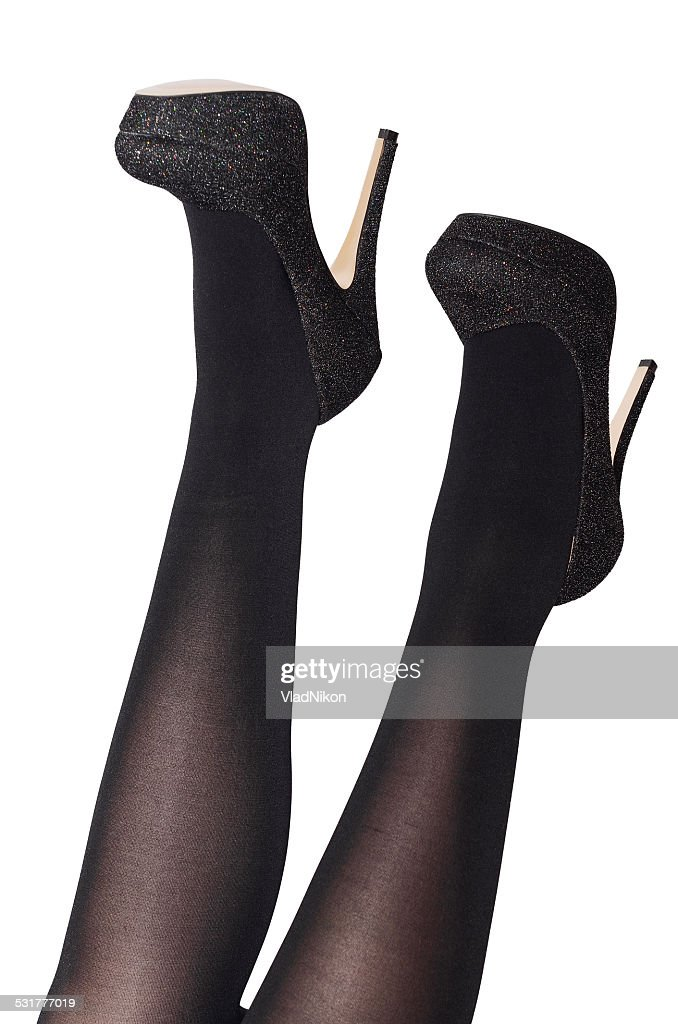 125392d4aa2 Beautiful sexy female legs in black tights with a butterfly   Stock Photo