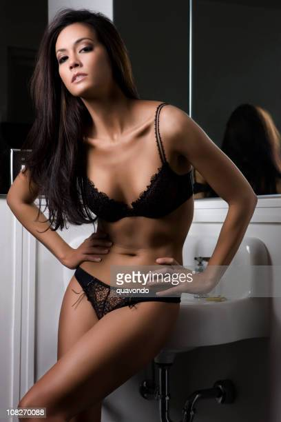 beautiful sexy tan brunette young woman wearing lingerie in bathroom - asian model stock photos and pictures