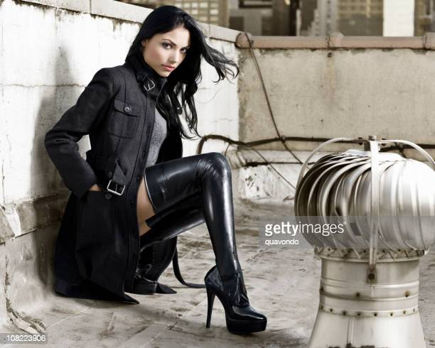 beautiful, sexy hispanic fashion model in boots on rooftop - leather boot stock pictures, royalty-free photos & images