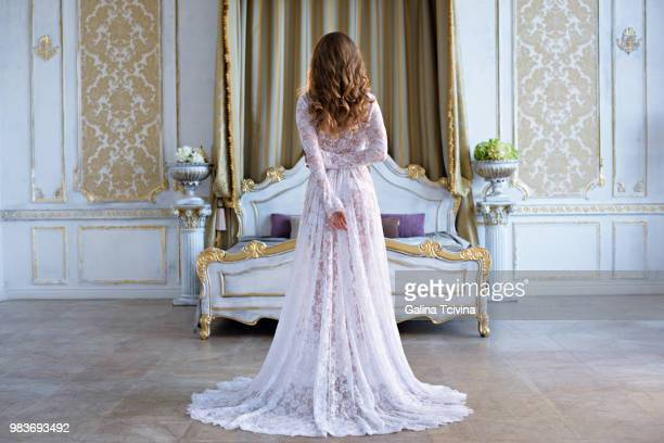 beautiful sexy lady in elegant white robe - veil stock photos and pictures