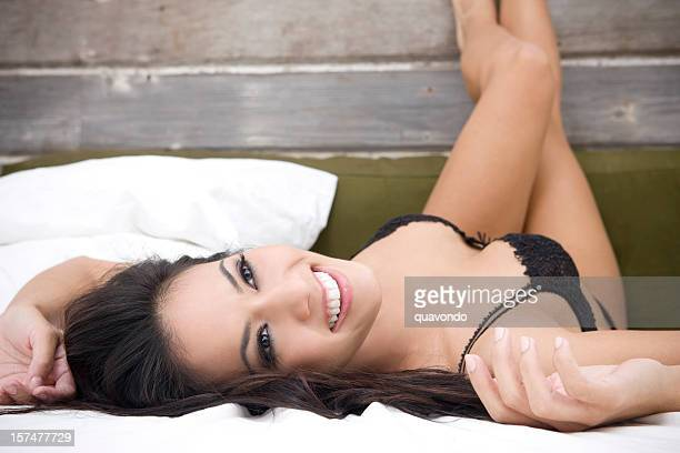 beautiful sexy woman in black lingerie at loft bed, copyspace - woman flat chest stock photos and pictures
