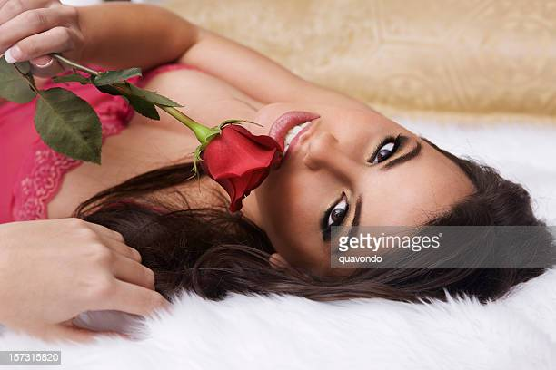 Beautiful Sexy Young Woman in Valentine Lingerie with Red Rose