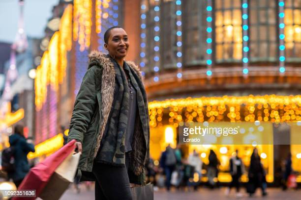 beautiful shaven headed woman at christmas shopping - hague market stock pictures, royalty-free photos & images