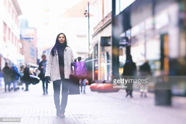 beautiful shopaholic woman standing street - helsingborg stock pictures, royalty-free photos & images