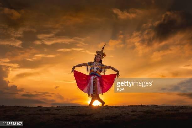 beautiful shot of menorah traditional thai dancing with unique clothing on sunset scene. thai cultures and performance art of southern thailand. - arte, cultura e espetáculo imagens e fotografias de stock