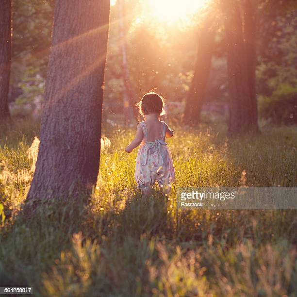 Beautiful shot of walking baby in sunset lights