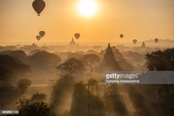 beautiful silhouette landscape view of sunrise morning and hot air balloon over ancient pagoda in Bagan , Myanmar 'Bagan is old Kingdom in Past of Burma