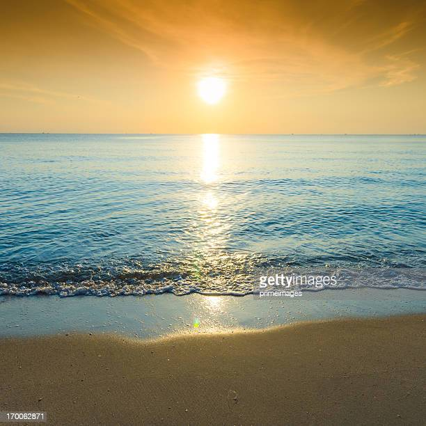 Beautiful silhouette sunset at tropical sea
