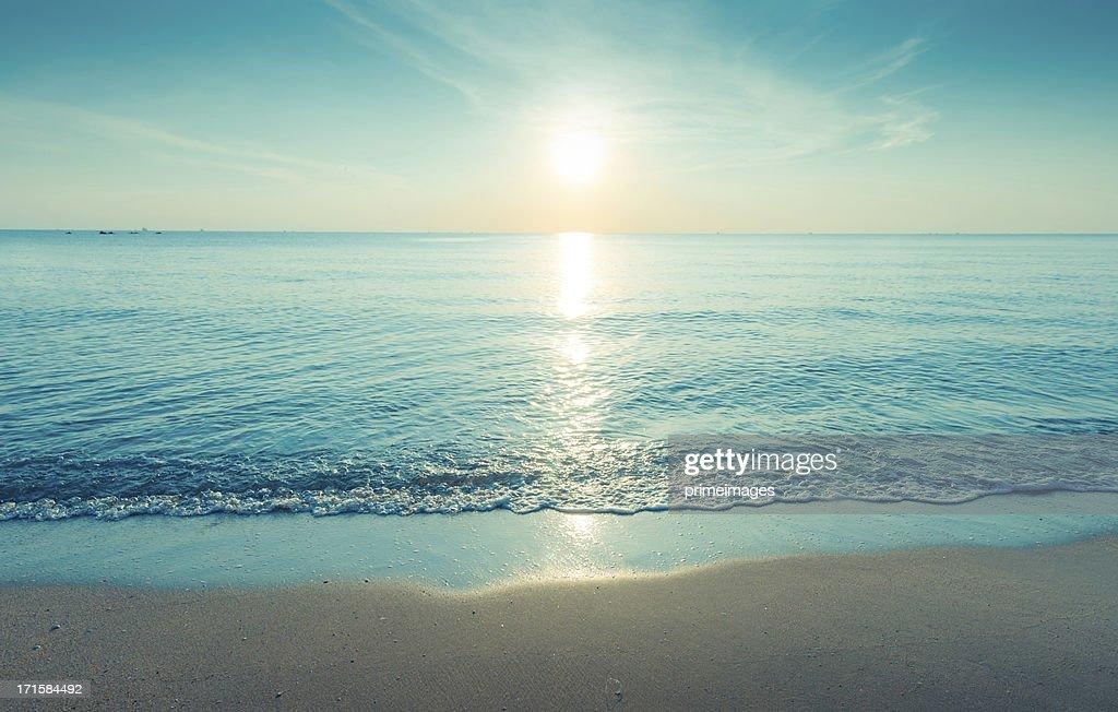Beautiful silhouette sunset at tropical sea : Stock Photo
