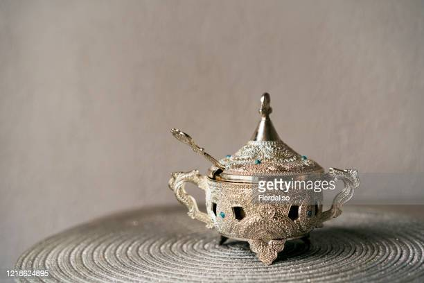 beautiful silver vase with a lid and a teaspoon for oriental-style treats - aid el kebir photos et images de collection