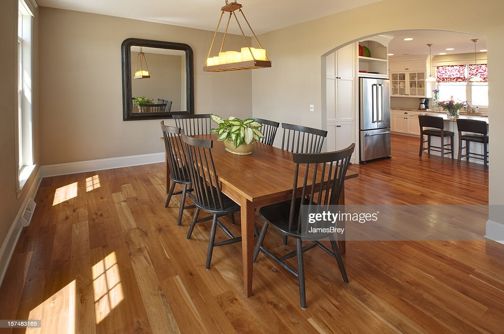 Beautiful Simple Country Style Dining Room, Hardwood Floor, Candle Chandelier : Stock Photo