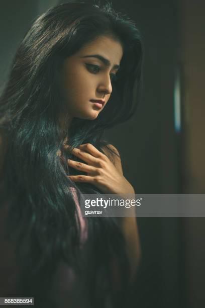 Beautiful single young woman thinking.