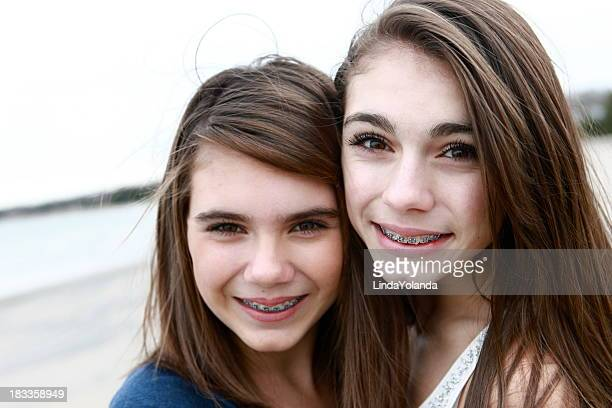 beautiful sisters - braces stock photos and pictures