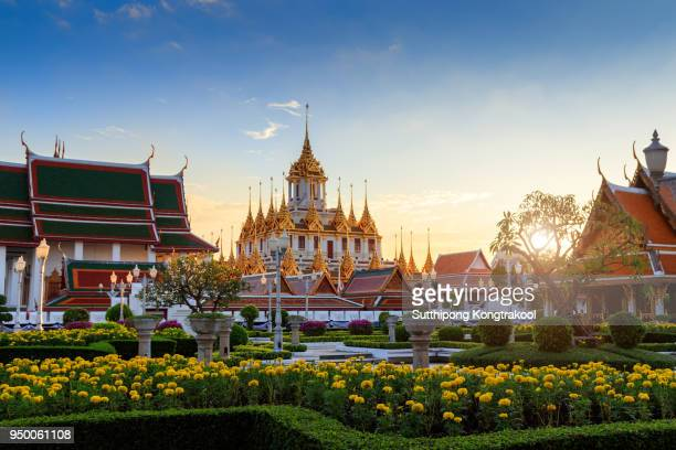 Beautiful sky and Wat Ratchanatdaram Temple in Bangkok, Thailand. Thai architecture: Wat Ratchanadda, Loha Prasat and Traditional Thai pavilion is among the best of Thailand's landmarks.