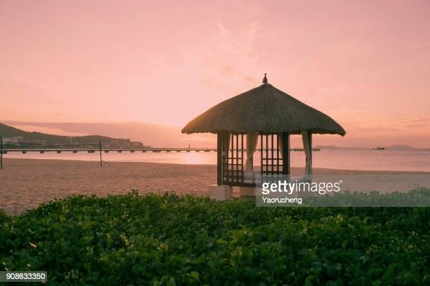 beautiful sky of sunset on the beach - sanya stock pictures, royalty-free photos & images