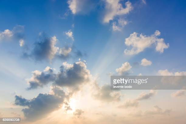 Beautiful sky with clouds and sun. Summer tropical beach sky clouds background concept design.