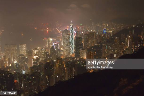 beautiful skyline of hong kong at night, glittering city lights - argenberg stock pictures, royalty-free photos & images
